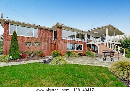 Red Brick House With Tile Roof. Back Yard