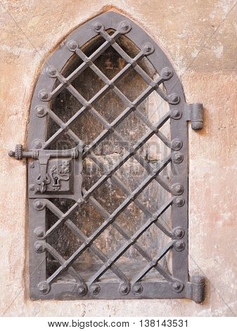 Medieval wrought iron fence door in a sand stone wall Germany 2016