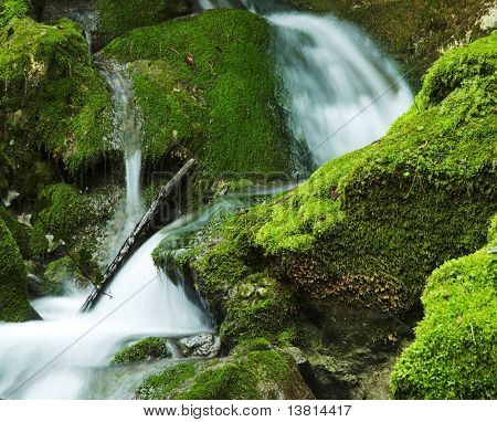 Beautiful small waterfall in green stone