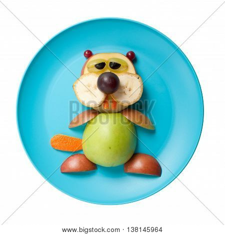 Funny beaver made of fruits on blue plate