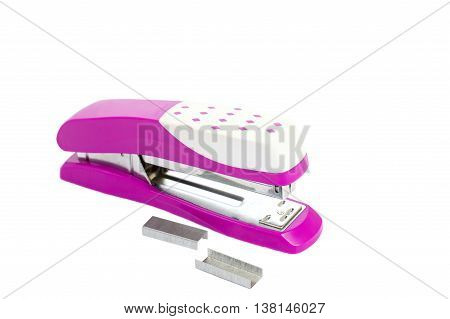 Closeup pink stapler office equipment isolated on white background with clipping path