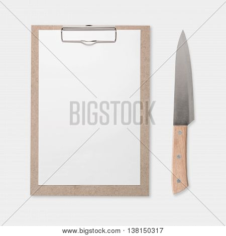 Design concept of mockup clip board and knife set isolated on white background. Copy space for text and logo. Clipping Path included on white background.