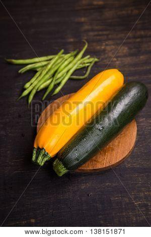 two fresh ripe raw wet vegetables zuccini in studio