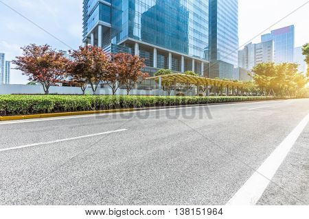empty road front of modern buildings