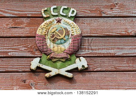 Coat of arms of the Soviet Union on an old railway car close-up