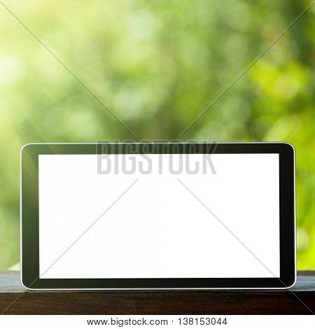 Tablet on the green bokeh backrounds. Like ipade