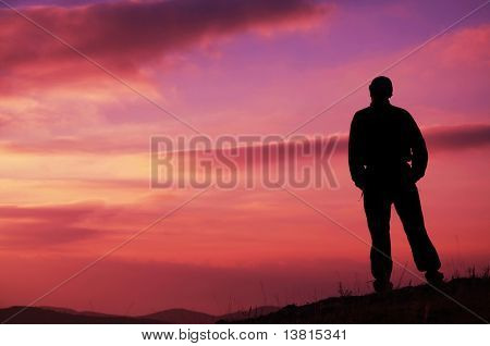 male silhouette on sunset