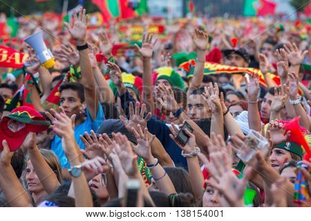 PORTO, PORTUGAL - JUL 10, 2016: Portuguese fans watch the football match Portugal - France final of the European championship 2016, in Liberdade Square at city center of Porto.
