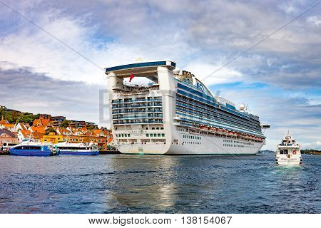STAVANGER, NORWAY - JULY 13, 2015: Luxury cruise ship Caribbean Princess with passengers on board in port. Stavanger is one of most famous cruise travel destinations in Europe.