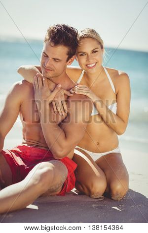 Romantic young couple having fun on beach