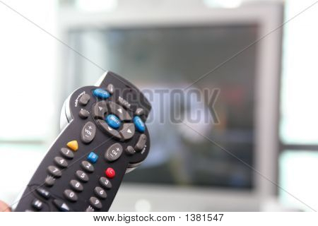Tv Remote Control With Tv In Background