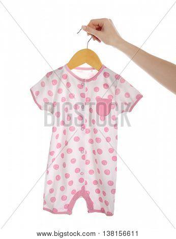 Female hand holding baby bodysuit on white background