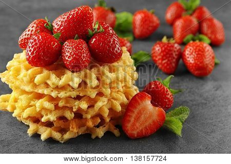 Tasty strawberries with wafers, closeup