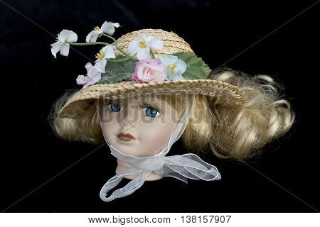 Little Girl Blonde Doll Head with Straw Hat on Black background