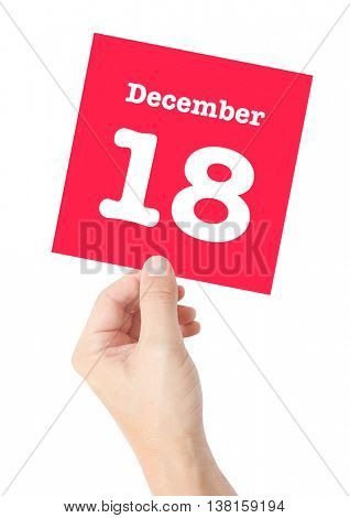 December 18 written on a card held by a hand