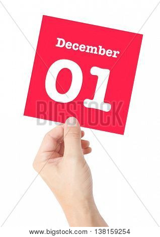 December 1 written on a card held by a hand