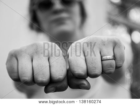 a close up of a girl's hands in black and white