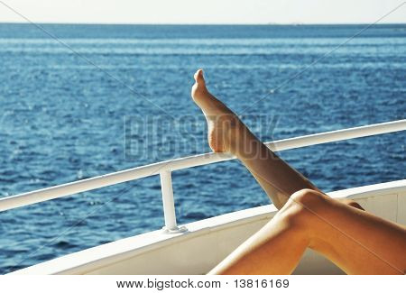 Relaxing woman on the yacht in sea