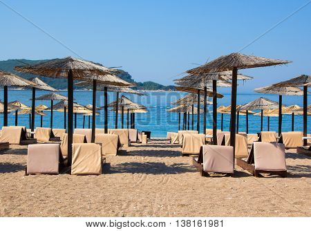 Sun loungers and umbrellas on the beach