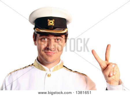 Man In Military Sailer Field Uniform With Hat Saluting
