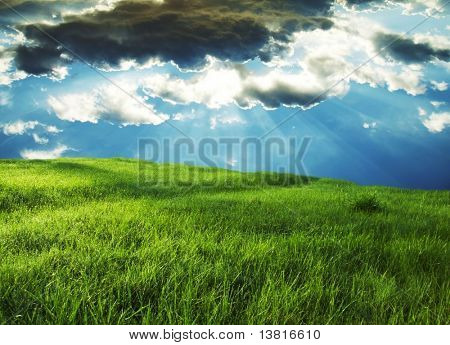 Green grassland and storm cloud