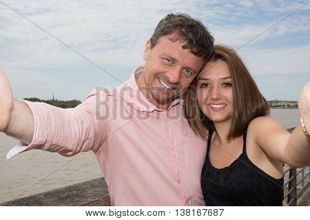 Beautiful Young Loving Couple At The Quayside With Smile