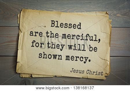 Jesus quote on old paper background. Blessed are the merciful, for they will be shown mercy.