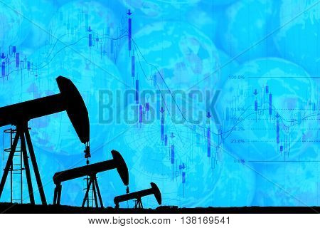 silhouette industrial oil pump jack and falling oil graph on the blue globe background