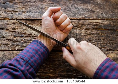 man wants to commit suicide on wooden background