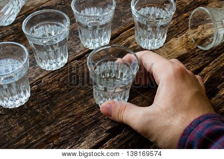 male alcoholic drinks vodka on wooden background