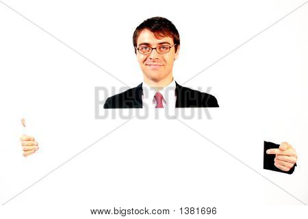 Smiling Atractive Man In Black Suit Showing His Business Card Poster