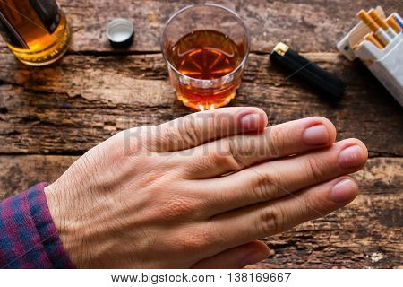 man refuses to alcohol and cigarettes on wooden background