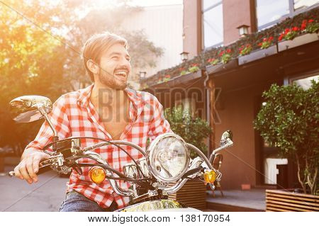 Handsome guy travel. Young rider enjoying the trip. Adventure and vacations concept.