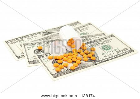 Orange Pill At The Money , Isolated On White Background