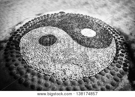 Yin Yang sign. Sort of symbolic stone. black and white photo.