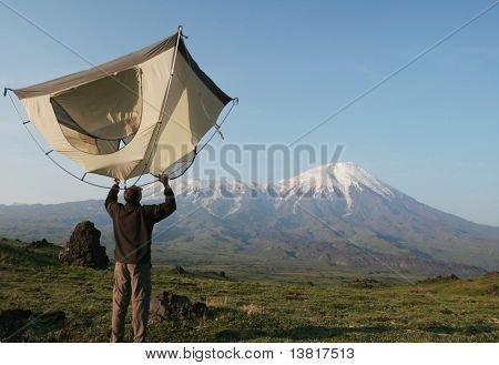 Man and tent in mountain on Kamchatka