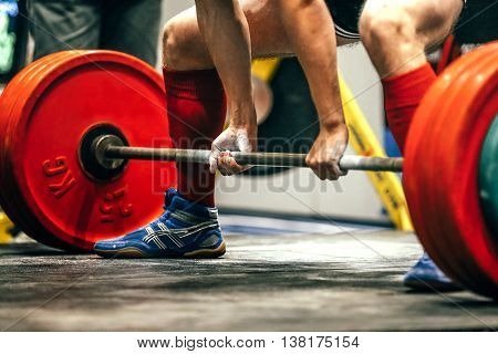 closeup of powerlifter to prepare exercise deadlift during competition of powerlifting
