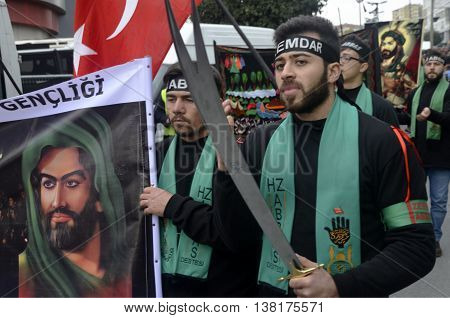Istanbul Turkey - November 3 2014: Universal Ashura Mourning Ceremony. A portrait of Prophet Mohammed's grandson Imam Hussein. A Universal Ashura Mourn Ceremony was held in Istanbul to commemorate the martyrdom of Husain ibn Ali the grandson of the Prophe