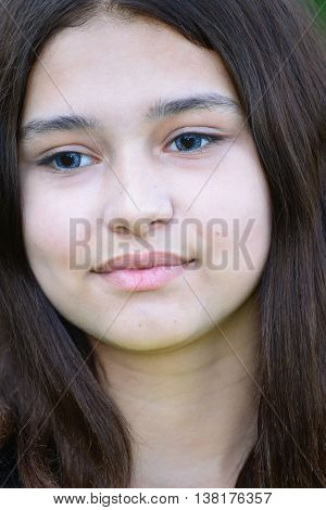 Close-up portrait of a teen girl of 14 years