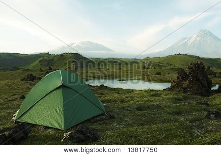 Green tent in Kamchatka mountains