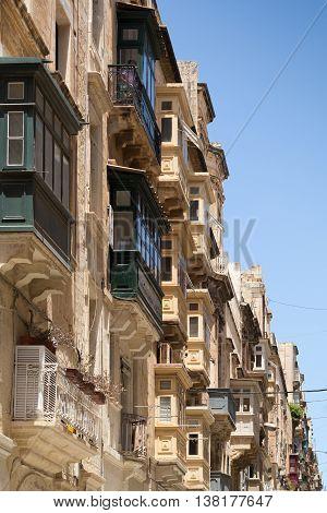 traditional wooden balconies warm sunlight Valletta Malta June 2016