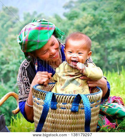 YEN BAI, VIETNAM, June 13, 2016 the mother carrying young children, ethnic Hmong, highland Yen Bai, Vietnam. So cute