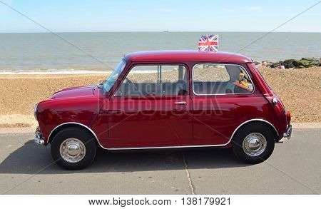 Felixstowe, Suffolk, England - May 01, 2016: Classic Red Austin Mini motor car parked on  Felixstowe seafront promenade.