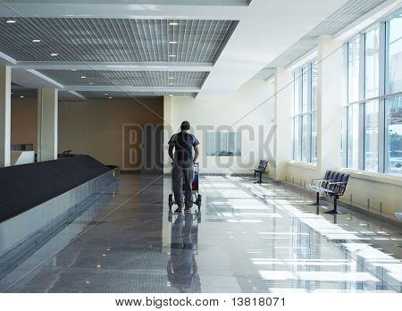 Man traveler walking the airport terminal