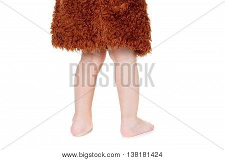 Legs funny Neanderthal boy in a suit. Humorous concept ancient caveman. Isolated on white.