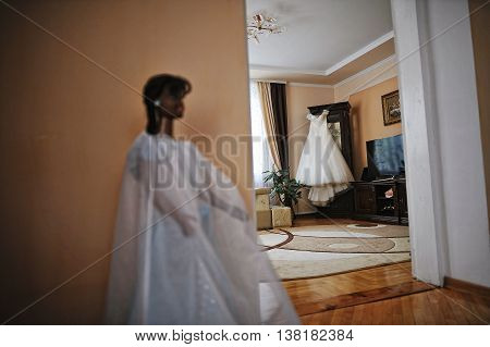 Brides Wedding Dress On Hangers At Room