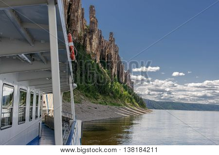 A travel boat arrived to National heritage of Russia Lena Pillars placed in republic Sakha, Siberia. View from a boat