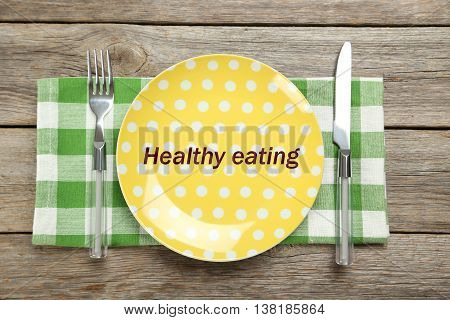 Yellow plate on a grey wooden table, healthy eating