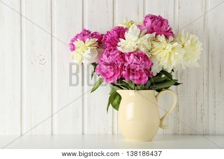 Bouquet Of Pink And White Peony Flowers On Wal Panelling Background