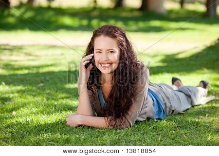 Woman Phoning In The Park